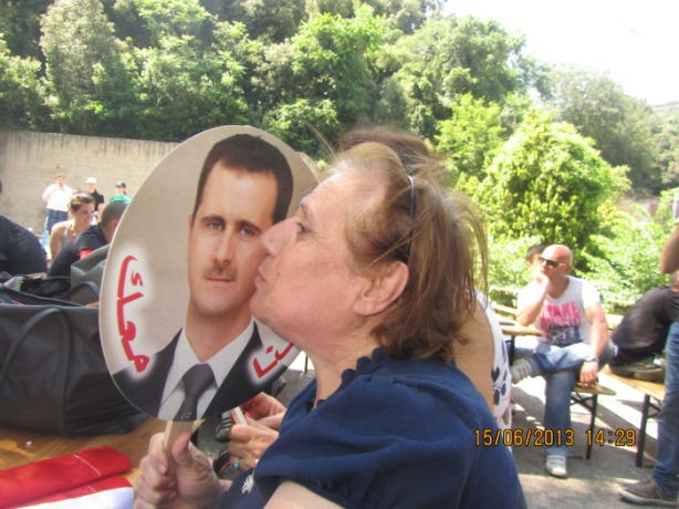 A woman showing her devotion in the Pro Assad rally in Rome