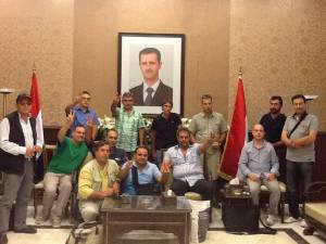 European delegation in support of Assad, containing members of the extreme right, Zenit, Casa Pound, Stato e Potenza, Fascisti del III Milennio,  Partito dei Comunisti Italiani. When Black and Red go to Bed together.