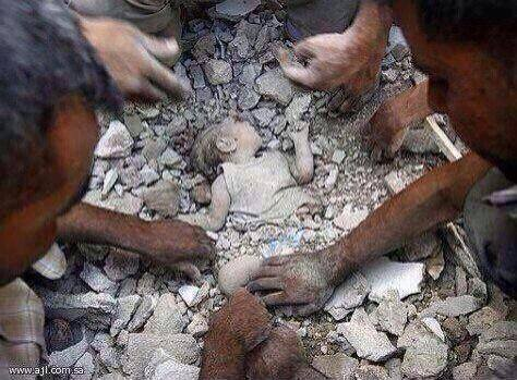One of the innocent victims of the bombing of Azaz. The Assad regime kills them an the world lets them dig the dead infants out with their bare hands.  This picture has also circulated with great success as having happened in Gaza.