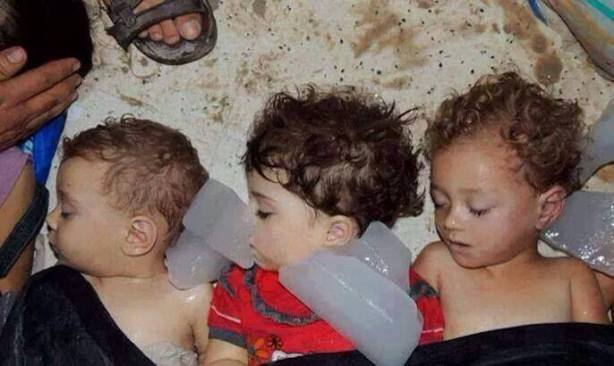 "Infant victims suffocated in their sleep by Sarin in Al Ghouta (at the Arbeen field hospital). The fate of these innocent vicitms was ""too horrifying"" to be shown, but that all changed when they were recycled as victims of Israel and not of Assad and our indifference."