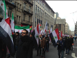 Ahwazi and Syrian freedom flags march together to demand the EU address their human rights.
