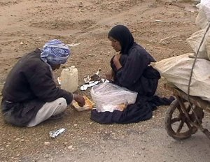 A destitute Ahwazi Arab couple, their home demolished by Iranian occupying forces, collect plastic from rubbish to sell simply in order to survive