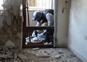 A UN chemical weapons inspector in Ghouta (Credit to: Ammar al-Arbini/AFP/Getty)