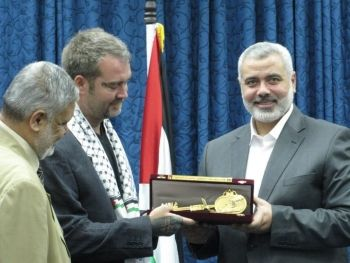 "Ken obtaining the ""Key to Gaza"" along with the symbolic passport. If you don't want to be seen as having any connection with someone in charge of what the US considers an FTO, you don't take your picture with them. Or else, you stop acting surprised that ""they know"" and have you on a ""list""."